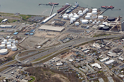 """Pearl Harbor Memorial """"Q"""" Bridge, West Bound Approaches just east of Bridge. I95 Woodward Avenue - old Stiles Street Interchange Aerial Photograph, view West including Gateway Terminal, Tank Farms & Freighters in Dock"""