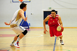 Bristol Academy Flyers' Roy Owen attempts to dribble past Essex Leopards' Tom Martin - Photo mandatory by-line: Dougie Allward/JMP - Tel: Mobile: 07966 386802 23/03/2013 - SPORT - Basketball - WISE Basketball Arena - SGS College - Bristol -  Bristol Academy Flyers V Essex Leopards