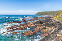 Rugged intertidal platforms exposed at low tide at Natures Valley, Garden Route National Park, Western Cape, South Africa