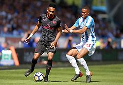 Arsenal's Pierre-Emerick Aubameyang (left) and Huddersfield Town's Mathias Jorgensen battle for the ball