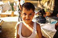 A Syrian refugee poses for a portrait at the Hotel Captain Elias in Kos, Greece on July 2, 2015. Migrants and refugees making the dangerous journey across the Mediterranean and Aegean seas into Europe risk the lives of their children with hopes for a better future for their families.