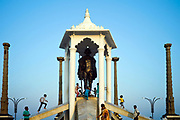 Children play on a statue of Mahatma Gandhi on the promenade at the beach at Pondicherry, India. Pondicherry now Puducherry is a Union Territory of India and was a French territory until 1954 legally on 16 August 1962. The French Quarter of the town retains a strong French influence in terms of architecture and culture.