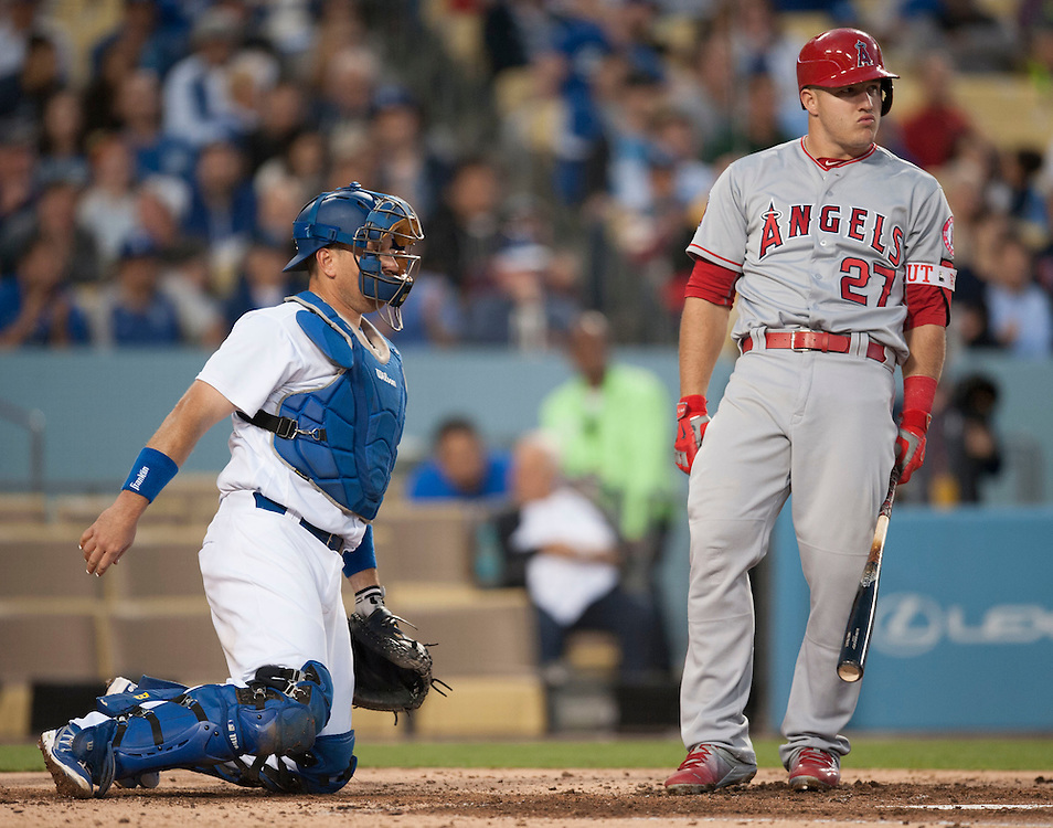 The Angels' Mike Trout doesn't look happy with a called strike in the third inning in front of the Dodgers catcher A.J. Ellis Tuesday night at Dodger Stadium.<br /> <br /> / //ADDITIONAL INFO:   <br /> <br /> angels.0518.kjs  ---  Photo by KEVIN SULLIVAN / Orange County Register  -- 5/17/16<br /> <br /> The Los Angeles Angels take on the Los Angeles Dodgers in inter-league play at Dodger Stadium Tuesday night.