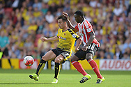 Jose Manuel Jurado of Watford holds the ball from Victor Wanyama of Southampton. Barclays Premier League, Watford v Southampton at Vicarage Road in London on Sunday 23rd August 2015.<br /> pic by John Patrick Fletcher, Andrew Orchard sports photography.
