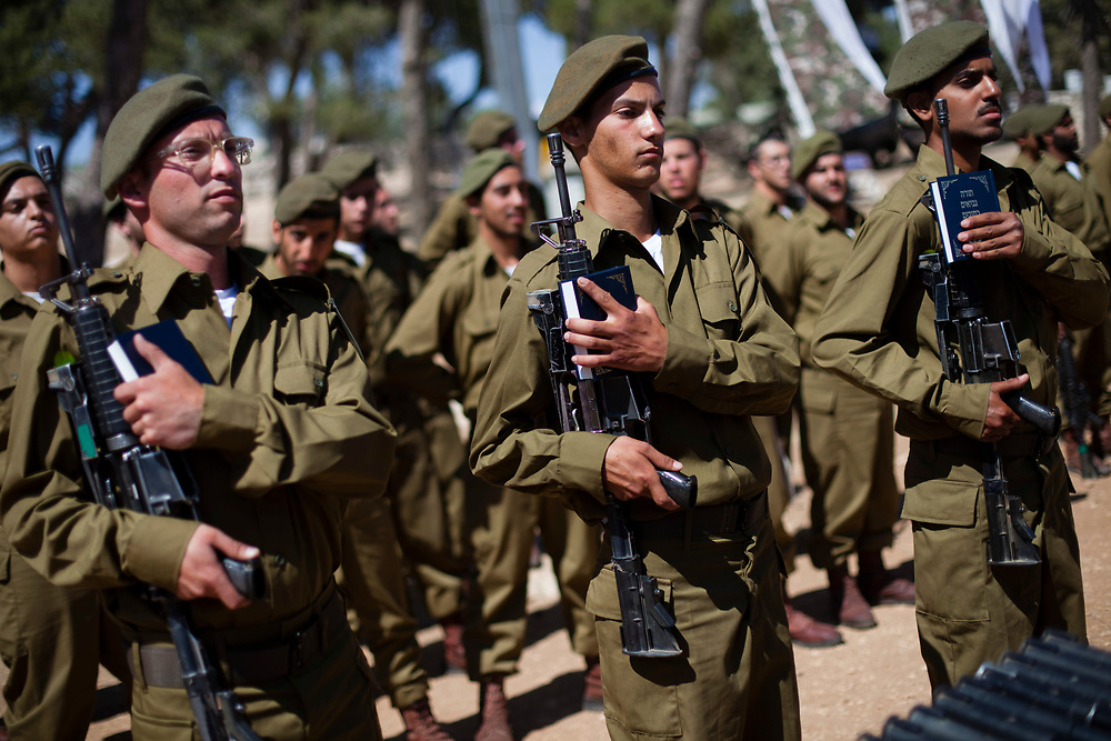 Israeli Jewish Orthodox and ultra-Orthodox soldiers of the Israeli military Netzah Yehuda Battalion ?(also known as Nahal Haredi brigade) are seen during their swearing-in ceremony held at the Ammunition Hill national memorial site in Jerusalem, Israel, on May 31, 2012. The unit, part of the Israeli Defense Forces Kfir Brigade, was created by a group of rabbis in cooperation with the IDF and Israel's Ministry of Defense, as a venue for young men who wish to serve the national interests of the state of Israel while adhering to the highest religious standards.