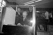 8/3/1965<br /> 3/8/1965<br /> 8 March 1965<br /> <br /> <br /> Éamon de Valera being shown the booths by An tath. Colman O huallachain O.F.M Director of AnTeanglann