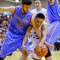 Gallup Bengal Seth Manuelito (25) gets tangled with Sandia Prep Sundevil Mohammed Assed (23) as they compete for a rebound Friday at Gallup High School. .