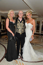 Left to right, MICHELLE MONE, JOHN CAUDWELL and CLAIRE CAUDWELL at a birthday dinner for Claire Caudwell for family & friends held at The Dorchester, Park Lane, London on 24th January 2014.