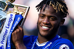 Michy Batshuayi holds the trophy as as Chelsea celebrate winning the 2016/17 Premier League - Rogan Thomson/JMP - 21/05/2017 - FOOTBALL - Stamford Bridge - London, England - Chelsea v Sunderland - Premier League..