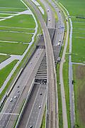 Nederland, Zuid-Holland, Gemeente Alkemade, 09-04-2014; infrastructuur bundel bestaande uit autosnelweg A4 en het hogesnelheidspoor HSL-Zuid. De verdiepte kruising HSL - A4, met viaduct van de hogesnelheidslijn over de lager gelegen snelweg. Veenweidelandschap tussen Roelofarendsveen en Rijpwetering.<br /> Infrastructure bundle consisting of A4 motorway and the high speed rail HSL. The HST crosses the recessed motorway junction.<br /> luchtfoto (toeslag op standaard tarieven);<br /> aerial photo (additional fee required);<br /> copyright foto/photo Siebe Swart.