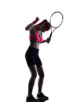 one woman tennis player  in studio silhouette isolated on white background