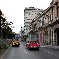 Central America, Cuba, Havana. Downtown Old Havana street and classic cars.