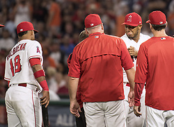 August 7, 2017 - Anaheim, CA, USA - Angels' JC Ramirez gets checked on his arm after a broken bat hits his arm during a game against the Orioles at Angel Stadium in Anaheim on Monday, August 7, 2017. (Credit Image: © Kyusung Gong/The Orange County Register via ZUMA Wire)