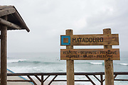 Respect, enjoy and preserve sign at Matadouro beach on 25th May 2018 in Ericeira in Portugal. Ericeira is a civil parish and seaside resort/fishing community on the western coast of Portugal.
