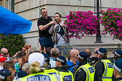 """Rally organiser Danny Tommo shorts right wing protesters to leave their pen in order to attack antifascists nearby as several hundred protesters in central London demand the release of """"political prisoner"""" right wing talisman Stephen Yaxley-Lennon  - also known as Tommy Robinson, who was imprisoned for contempt of court. London, August 03 2019."""