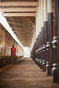 A man walks the platform waiting to board a train at the Nairobi Railway Station, Kenya