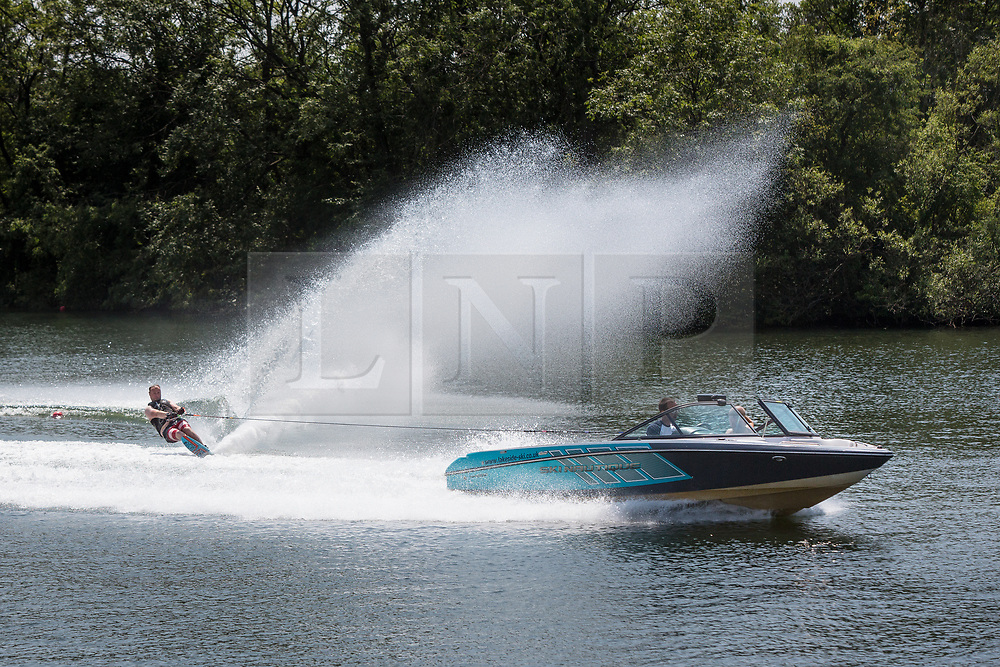 © Licensed to London News Pictures 28/06/2108, Cirencester, UK. People are out enjoying the continued hot weather as they practices slalom water skiing at the Cotswold Water Park near Cirecenster, Gloucestershire. Photo Credit : Stephen Shepherd/LNP