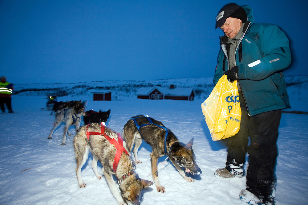 The Finnmarksløpet 2007, 10th - 17th March. At 1000km, this is the longest and northernmost dog sledging race in Europe. .3rd placed contestant Harald Tunheim, arrives at the check point of Joatka.