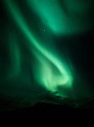 Beautiful green aurora with clouds over Sheep Mountain on the night of September 26, 2001, Tahneta Pass, Alaska.