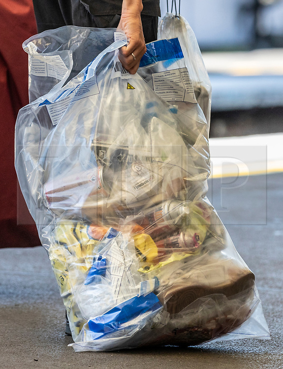 © Licensed to London News Pictures. 18/06/2018. London, UK. Cans of spray paint are seen in an evidence bag after three bodies were discovered near Loughborough Junction station after they were reportedly hit by a train. Photo credit: Rob Pinney/LNP