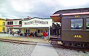 Alaska. White Pass and Yukon Railroad,   passes throughthe streets of Skagway in summer.