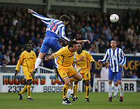 Fotball<br /> Foto: SBI/Digitalsport<br /> NORWAY ONLY<br /> <br /> Hartlepool United v Tranmere Rovers, Coca-Cola League 1 Play-offs First Leg, Victoria Park, Hartlepool 13/05/2005.<br /> <br /> Tranmere's Ian Sharps (C) feels the pain as Hartlepool's Jon Daly (#16) rises above him.