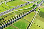 Nederland, Gelderland, Gemeente Neder-Betuwe, 30-09-2015; goederentrein onderweg van Duitsland naar de Haven van Rotterdam op de Betuweroute. Omgeving Ochten, de autosnelweg A15 loopt parallell aan de spoorlijn.<br /> Freight train en route from Germany to the Port of Rotterdam on the Betuweroute.  A15 motorway runs parallell to the railroad.<br /> luchtfoto (toeslag op standard tarieven);<br /> aerial photo (additional fee required);<br /> copyright foto/photo Siebe Swart