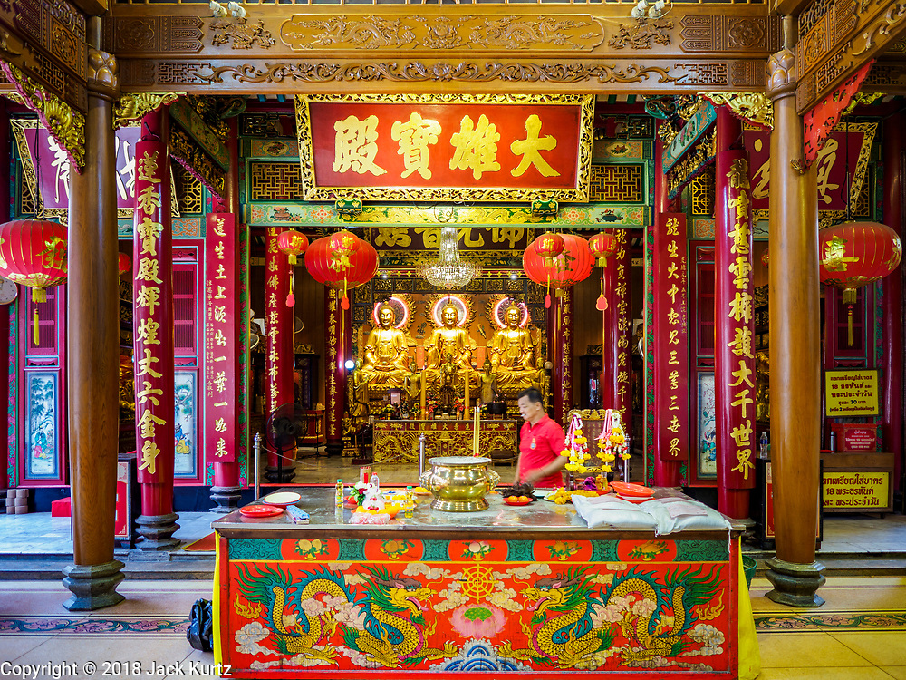 31 JULY 2018 - BANGKOK, THAILAND: The meditation hall at Wat Mangkon Kamalawat, the largest Mahayana Buddhist temple in Chinatown. Bangkok's Chinatown district is one of the largest Chinatowns in the world. It was established in 1781 when Siamese King Rama I gave the Chinese community in Bangkok land outside of Bangkok's city walls so he could build his palace (what is now known as the Grand Palace). Chinatown is now the heart of the Thai-Chinese community. About 14% of Thais have Chinese ancestry.   PHOTO BY JACK KURTZ