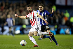 Sheffield United's Enda Stevens in action with Sheffield Wednesday's Adam Reach