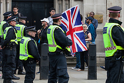 London, UK. 9th June, 2018. Supporters of Tommy Robinson, former leader of the far-right English Defence League, try to reach the March for Tommy Robinson outside Downing Street.