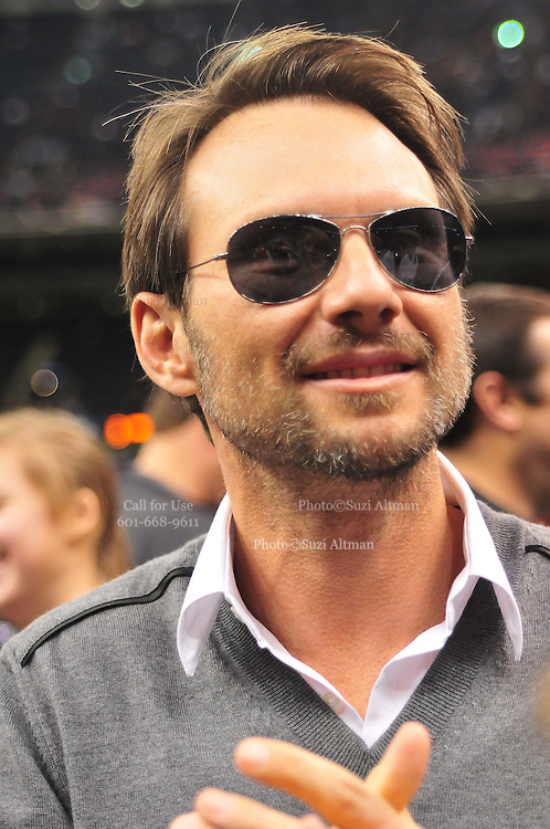 Actor Christian Slater enjoys the Saints fans on the sidelines prior to the kickofff Sunday Nov. 21,2010 in New Orleans Louisiana in the Super Dome. The Saints went on to beat the Seahawks 34-19. Photo©SuziAltman.