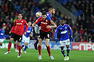 Mark Hudson of Cardiff city (5) is challenged by David McGoldrick. NPower championship, Cardiff city v Ipswich Town at the Cardiff city Stadium in Cardiff, South Wales on Saturday 12th Jan 2013. pic by Andrew Orchard, Andrew Orchard sports photography,