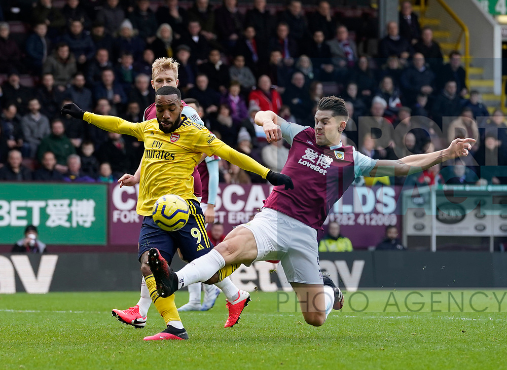 James Tarkowski of Burnley makes a last ditch tackle on Alexandre Lacazette of Arsenal as he prepares to shoot during the Premier League match at Turf Moor, Burnley. Picture date: 2nd February 2020. Picture credit should read: Andrew Yates/Sportimage