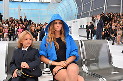 File photo - Model Cara Delevingne and Hudson Kroenig attending the Chanel show as part of the Paris Fashion Week Womenswear Spring/Summer 2016 on October 6, 2015 in Paris, France. Karl Lagerfeld died on Monday at age 85. One who may inherit is his godson Hudson. Hudson's dad, model Brad Kroenig, is like 'family' to Lagerfeld. Hudson began modeling for Chanel at age two and had continued to pop up on the runway ever since. Photo by Laurent Zabulon/ABACAPRESS.COM
