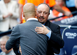 Manchester City manager Pep Guardiola (left) with Newcastle United manager Rafael Benitez before kick-off during the Premier League match at the Etihad Stadium, Manchester.