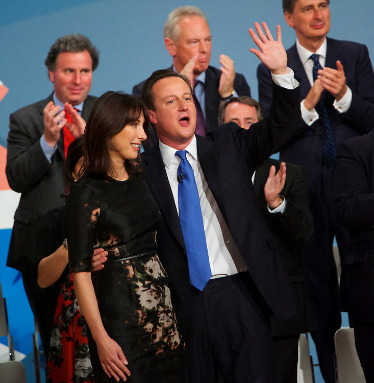 Prime Minister David Cameron and wife, Samantha, acknowledge the audiences applause having delivered his leader's speech on the fourth, and final, day of the Conservatives Party Conference at the ICC, Birmingham, England on October 6, 2010.  Mr. Cameron delineated the controversial spending cuts which have drawn much ire of the public and fellow MPs alike.