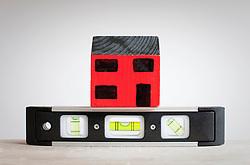 Model of house and sprit level (Credit Image: © Image Source/Ian Nolan/Image Source/ZUMAPRESS.com)