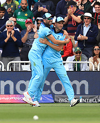 England's Chris Woakes (right) celebrates the catch of Pakistan's Imam-ul-Haq (not pictured) with team mates during the ICC Cricket World Cup group stage match at Trent Bridge, Nottingham.