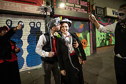 © Licensed to London News Pictures . 28/10/2018. Manchester, UK. A couple dressed up as characters from Mary Poppins pose on Thomas Street in the Northern Quarter of Manchester City Centre . Revellers on a night out , many in fancy dress , on the weekend before Halloween . Photo credit: Joel Goodman/LNP
