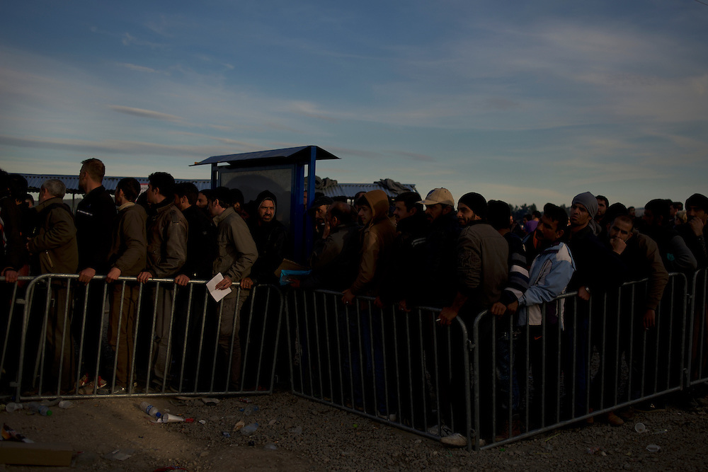 Migrants and refugees queue for registration on arrival at the border between Greece and Macedonia in Idomeni, Greece. Around 13,000 migrants and refugees, mostly from the Middle East and African nations, are believe to be stranded here awaiting a chance to proceed their journey towards Germany and other northern European countries.