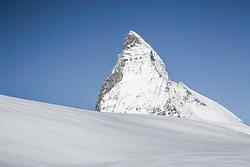 A pristine snowy slope below the Matterhorn in Zermatt Switzerland