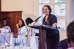 Dr. Beverly Lansiquot, Dean of Nursing, gives a message of inspiration to the graduates.  Ten graduates of the University of the Virgin Islands School of Nursing commemorated their graduation with a pinning ceremony and lighting of candles while surrounded by nursing alumni, family, and friends.  University of the Virgin Islands School of Nursing 2015 Pinning Ceremony.  St. Thomas Reformed Church.  St. Thomas, VI.  12 May 2015.  © Aisha-Zakiya Boyd