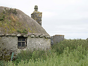 An abandoned blackhouse in the village of Garrynamonie on the Isle of South Uist, Outer Hebrides, Scotland on 23 July 2018
