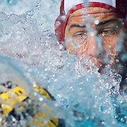 November 4th, 2016; Mission Viejo, California, USA; A Saddleback College water polo player reaches for a ball in a match against Golden West College. (Eric Cech, Sports Shooter Academy)