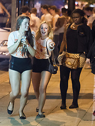 """© Licensed to London News Pictures . 22/10/2012 . Manchester , UK . Actress Brooke Vincent (left) (aka Sophie Webster in Coronation Street ) leaves the event with another woman . Students attend a Carnage UK pub crawl at bars in Manchester 's Deansgate Locks with a fancy dress theme of """" Pimps and Hoes """" . The event has been criticised for encouraging binge drinking , sexism and anti-social behaviour . Photo credit : Joel Goodman/LNP"""