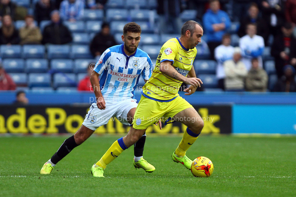 Gary Taylor-Fletcher of Sheffield Wednesday gets away from Tommy Smith of Huddersfield Town. Skybet football league championship match, Huddersfield Town v Sheffield Wednesday at the John Smith's stadium in Huddersfield, Yorkshire on Saturday 22nd November 2014.<br /> pic by Chris Stading, Andrew Orchard sports photography.