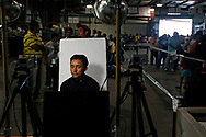 Fernando Haro, 19, waits to have his picture taken so that the Mexican Consulate can issue him a matricula identification card. The card will allow him to open a U.S. bank account as well as obtain a drivers license.
