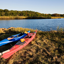 Kayaks on the shore of the lower, tidal portion of the Taunton River in Dighton, Massachusetts.  Recently designated a Wild and Scenic River.  SUmmer.