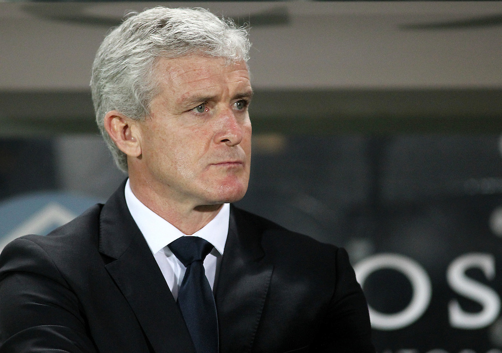 Stoke City's Manager Mark Hughes  looks disappointed as his side fail to earn an away victory against Hull City <br /> <br /> Photo by Rich Linley/CameraSport<br /> <br /> Football - Barclays Premiership - Hull City v Stoke City - Saturday 14th December 2013 - Kingston Communications Stadium - Hull <br /> <br /> © CameraSport - 43 Linden Ave. Countesthorpe. Leicester. England. LE8 5PG - Tel: +44 (0) 116 277 4147 - admin@camerasport.com - www.camerasport.com