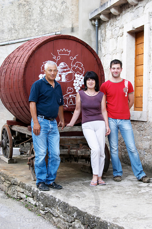 Frano and Paval Banicevic, father and son and Frano's wife, two generations winemakers, in front of the winery. Toreta Vinarija Winery in Smokvica village on Korcula island. Vinarija Toreta Winery, Smokvica town. Peljesac peninsula. Dalmatian Coast, Croatia, Europe.